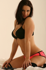 **Photo Update 12/10/12 -  Tina  In bed wearing a sexy black and pink bra and panty set but oh not for very long!**